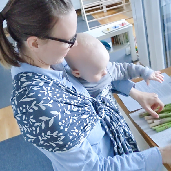 Babywearing mom cooking